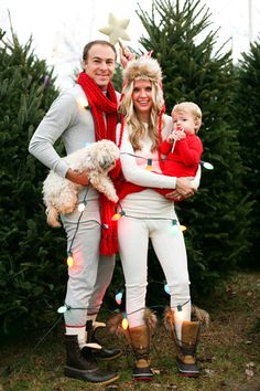 It's adorable, it works what can I say? Love the tree farm idea. lights, baby in PJ's. Note the strategic placement of dad's scarf. Long johns might as well be ballet tights, ahem.