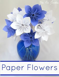 Paper Flower Tutorial. Each flower has five petals that have are folded (origami style), and taped together.