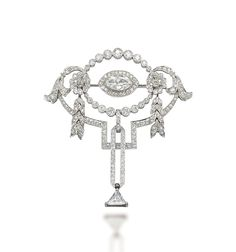 A BELLE ÉPOQUE DIAMOND BROOCH, BY T.B. STARR  Of openwork design, centering upon a marquise-cut diamond within a graduated collet-set diamond line, to the two diamond flowers and flexible foliate pendants, suspending a diamond-set twin bar pendant, with a later added triangular-cut diamond terminal, 1910s, 6.1 cm  Signed T.B. Starr