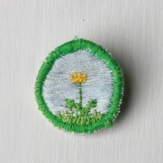 Dandelion Merit Badge -   Handmade, one of a kind, and not the least bit nerdy.    This hand-embroidered merit badge lets everyone know how awesome you are. Complete with a pin back, you can show it off on a t-shirt, backpack, or cardigan, or wear it with your Whimsy Scout sash!