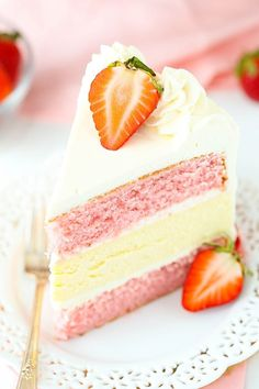 This Is the Most Popular Strawberry Recipe on Pinterest. A beautiful, impressive strawberries and cream layer cake made with fresh berries and a layer of homemade cream cheese cheesecake in the middle.
