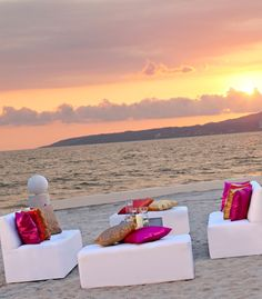 A sunset is the perfect backdrop for a destination wedding reception at Dreams Villamagna