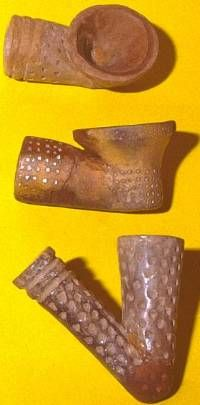 Late Caddo ceramic pipe bowls from the A.C. Saunders site in northeast Texas. Wooden or bone stems were added to such pipe bowls. Tobacco was grown by the Caddo and was used in both ritual and ordinary settings. The Caddo greeted early Spanish and French visitors with the calumet or smoking-pipe ceremony as was common among many Southeast and Plains groups.