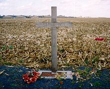 """A cross, left in Saint-Yves (Saint-Yvon - Ploegsteert; Comines-Warneton in Belgium) in 1999, to commemorate the site of the Christmas Truce. The text reads: """"1914 – The Khaki Chum's Christmas Truce – 1999 – 85 Years – Lest We Forget"""""""