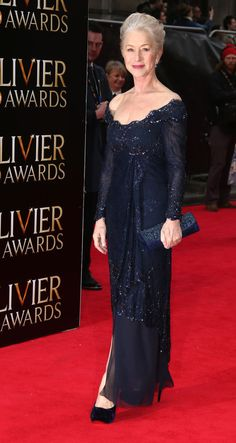 Helen Mirren (age 67) in blue lace full-length gown before winning Best Actress at Laurence Olivier Awards, London, England