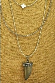 Three strands of seeds beads with the longest falling at 24 inches and dangling a polished horn. The two outside strands are silver and the center is gold for lovely contrast. A Sterling Silver cross adorns the inner most strand.