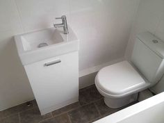 Close Coupled Toilet And Small Basin With Bathroom Installation In Leeds