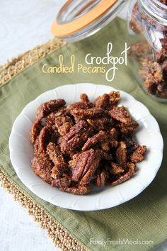 Crock pot candied pecans make the perfect fall snack mix for watching a movie by the fire.