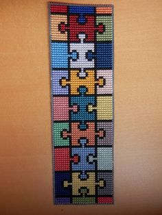 Completed cross-stitch bookmark on plastic canvas - jigsaw pattern Cross Stitch Freebies, Cross Stitch Books, Cross Stitch Bookmarks, Cross Stitch Art, Cross Stitch Borders, Cross Stitch Alphabet, Cross Stitch Designs, Cross Stitching, Cross Stitch Embroidery