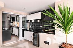 Área gourmet como extensão da cozinha apostando no preto e branco, criou uma unidade visual.