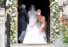 The duchess, the former Kate Middleton, adjusted her sister's veil before the ceremony.