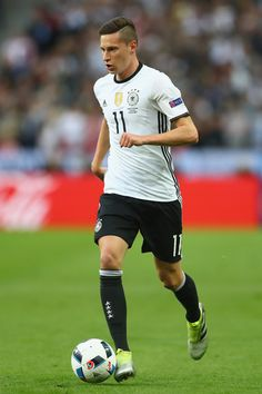 Julian Draxler  of Germany runs with the ball during the UEFA EURO 2016 Group C match between Germany and Poland at Stade de France on June 16, 2016 in Paris, France.
