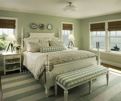 This master bedroom is found in this couple's summer home…what a beautiful ocean view!