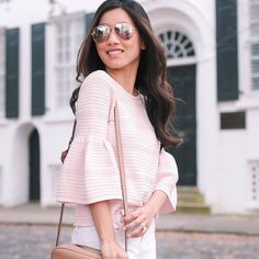 The always-stylish @extrapetite is so pretty in our pink pointelle drama sleeve sweater. #regram P.S. It's now an extra 40% off. Click quick—sizes are limited. #whbm