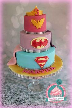 Girls superhero cake super girl bat girl and Wonder Woman by www.candyscupcakes.co.uk