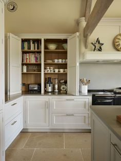 Our clients were keen to incorporate enough storage to avoid having clutter on the worktops of their new kitchen. This breakfast pantry cupboard, positioned directly on the worktop, is the ideal place to store crockery and small appliances. They can easily be pulled out when needed, then slid back in and wiped clean after use.