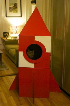 Tutorial for a cardboard cat house shaped like a rocket. Boocat NEEDS you to make this for him, A. Get on that! Tutorial by Haley Pierson-Cox