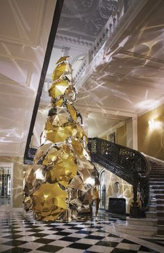 Claridge's, London's legendary Mayfair hotel, has unveiled the Claridge's Christmas Tree 2015 in the hotel lobby, designed by Christopher Bailey, Burberry Chief Creative. It's the first Claridge's has had a British designed Christmas Tree. http://ow.ly/UI8KW