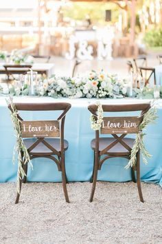 rustic bride and groom chairs | chair treatments | slate blue peach wedding | legends ranch wedding