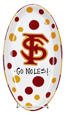 Invite your friends over to watch your favorite college team play to win, and serve delicious appetizers on this ceramic 12'' oval platter. Platter is hand-painted with the FSU logo in the center surrounded by polka dot. Dishwasher