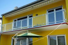Give your home a distinctly European look with the addition of a glass panel balcony railing. Glass panels maximize visibility and safety. Exterior Stair Railing, Outdoor Handrail, Pipe Railing, Balcony Railing, Patio Roof, Metal Railings, Building Furniture, Pipe Furniture, Deck With Pergola