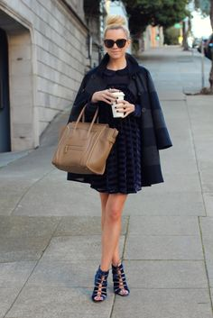 Peter Pan collar, cape, colors...I'm loving her. Finally someone on the west coast who's style I like.