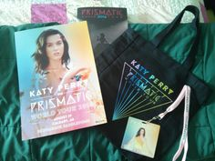 most of what came in my @katyperry #PrismaticWorldTour VIP package #moneylove values 1 + 4: Katy is a HUGE inspiration to me + I couldn't NOT go to her show. Having these mementos to remind me of the experience is rainbow sparkles icing on the cake. #BESTSHOWEVER #KatyCat