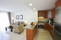 Spacious kitchen and living room in one of the Beverly Hills Club apartments