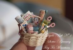 EEeep!  Teeny tiny basket of miniature knitting supplies!  CUTE!