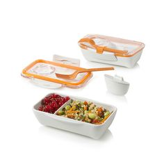 Bento Box Orange by Martin Black + Daniel BlumThis design follows on the success of Black+Blum's Box Appetit lunchbox. Its glass-like lid clamps to a bottom dish, creating a watertight lunch container. It is half the width of the original design and this allows you to carry it upright in your bag. The volume is perfect for pasta, rice or even sushi. This ingenious design also incorporates a clip to hold the fork (or your own chopsticks).