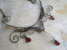 Gorgeous wire work! Looks a bit steampunk.