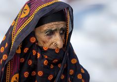Old veiled woman in Ibra, Oman by Eric Lafforgue