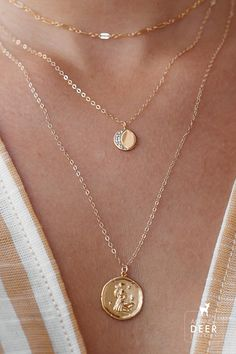 What's your sign? Our Zodiac necklaces are perfect for layering with your other dainty gold pieces! Shop the look at Amanda Deer Jewelry! #zodiac #layerednecklaces #goldnecklaces #zodiacnecklace #celestial #crescentmoon