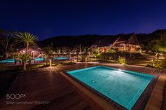 Popular on 500px : Tropical resort with swimming pool by SasinTipchai | Photo Snapping