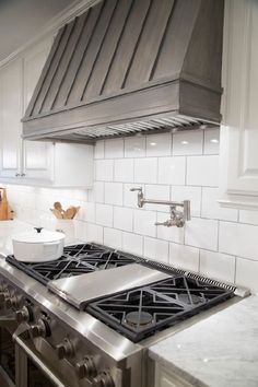 50 Trendy Hood Vents To Spice Up Your Kitchen Fixer Upper Farmhouse Kitchen By Chip And Joanna Gaines Gray Stained Wood Covered Range Hood Kitchen Vent Hood, Kitchen Stove, Kitchen Tiles, Kitchen Colors, New Kitchen, Kitchen Decor, Kitchen Cabinets, Kitchen Exhaust, Soapstone Kitchen