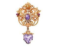 AMETHYST PEARL AND DIAMOND BROOCH, CIRCA 1900 Of openwork foliate design, featuring a cabochon amethyst and seed pearl cluster, highlighted with seed pearls, rose cut diamonds and circular cut rubies, suspending a heart shaped amethyst drop with ribbon detail, mounted in 15ct gold.