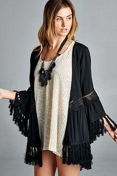 Solid, kimono featuring lace trim and fringe detail around sleeves and bottom hem. Unlined. Slightly sheer. Lightweight.