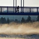 A mist hovers over the open water on the North Saskatchewan River as a runner goes across the Dudley B. Menzies LRT bridge walkway in Edmonton, on March 25, 2013. Photo by Ed Kaiser/Edmonton Journal #yeg #fog #mist #river #bridge #running #edmonton #alberta #canada #ejlensmen