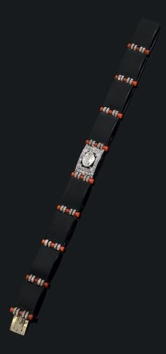 Cartier - A rare Art Deco platinum, enamel, coral and diamond bracelet, circa 1930. Signed Cartier Paris.