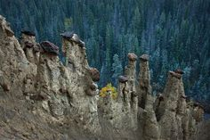 Hoodoos Yoho NP Canada. Photo by @peteressick. What is a hoodoo? It is a glacial moraine where large boulders protect the sediment below causing the capped pillars. Yoho NP has some of the best examples in the Canadian Rockies. by natgeo