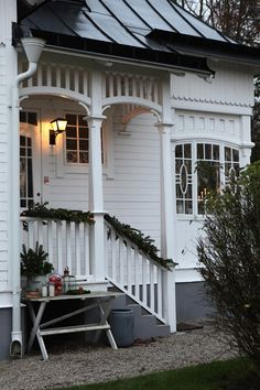 Holiday heaven, I would love to spend an evening on a porch like this. Swedish Cottage, Swedish House, Pergola, Decor Scandinavian, Cottage Style Homes, Inspired Homes, Porch Decorating, Victorian Homes, Architecture Details