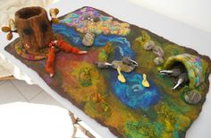 Take a moment and visit this Etsy shop - her work is INCREDIBLE! Waldorf Playscape Playmat with a cave river rocks by SooSun
