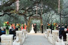 Camp Lucy Sacred Oaks (Dripping Springs, TX). I LOVE everything about this...the trees, the limestone, the dresses, her dress, the vine arch...everything.