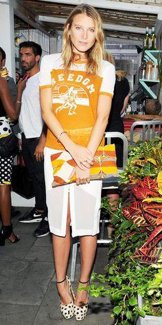 Dree Hemingway in a Etoile Isabel Marant shirt, Dion Lee skirt, Prada bag, Rochas Closed Toe Pumps