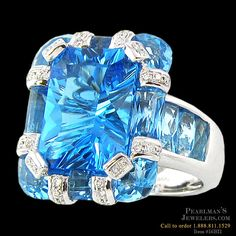 A stunning 18K white gold blue topaz and diamond ring from Bellarri. The total carat weight of the blue topaz is 7.30 and the surrounding diamonds have a weight of 0.17ctw. The ring's head Dimensions are: 20mm x 16mm. This is a true work of art.