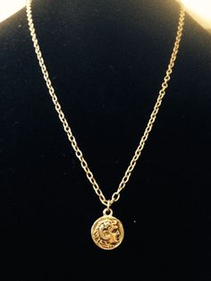 Ammon necklace like pendent in gold.  By Renewed Root.