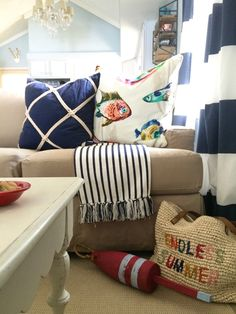 Summer Home Tour: It's a Shore thing at the Lake. Colorful watercolor fish and rope accented pillows, striped throw blankets and nautical inspired home decor create the perfect cottage look. Create your own ENDLESS SUMMER with nautical accessories at HomeGoods. Sponsored Post