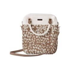 This beauty is 2 bags in 1! can be worn as a Hip Bag or used to store a tablet. Taupe faux leather is complemented by snowy-white round short handles and bag details. Cream abstract leopard print was custom-created by Miche—you won't see it anywhere else! Peek-a-boo back zippered pocket is ultra-convenient;roomy interior is lined with aqua cotton and features a zippered pocket and 4 card slots. Also comes with an adjustable long strap for cross-body toting. Bag is completely self-contained.