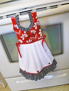 Flowers and ladybugs on this red, white and black kitchen hand towel, what a great addition to your room! The skirt is made from a white hand