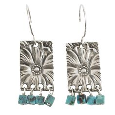 The flower is like a mini western engraved belt buckle with delightful turquoise dangles